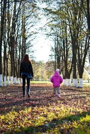 Mother and daughter walking in the park Stock Photo - 12534890