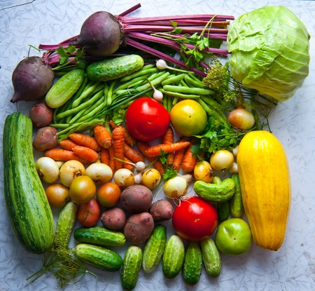Not neatly folded and various vegetables  Gifts of the summer  Stock Photo