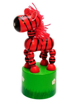 springy: isolated wooden toy  springy red horse with a fishing line inside Stock Photo