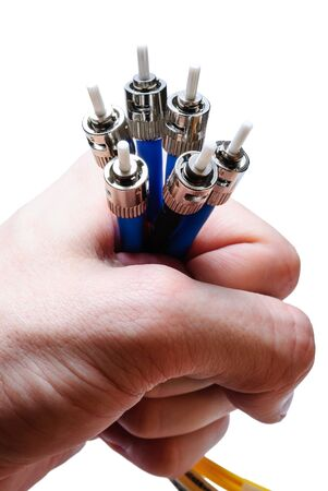 Several optical connectors ST-type in hand  Isolated on a white background  photo