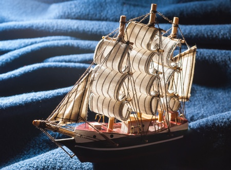 A toy boat on the waves of improvised  Overall appearance  The horizontal composition  Frontlight  photo