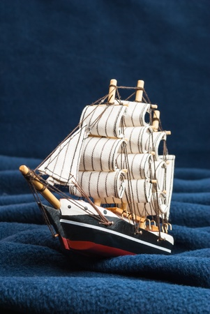 A toy boat on the waves of improvised  Overall appearance  The vertical composition  photo