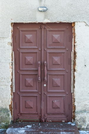 Front door in an old dilapidated house photo