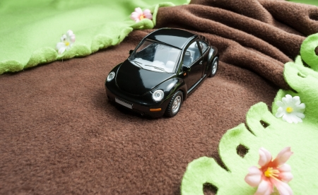Toy car on the road Stock Photo - 13673122