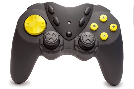 Black game controller with yellow buttons