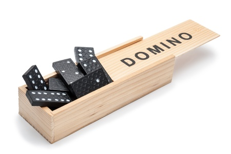 Dominoes, randomly placed in a box  photo