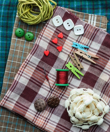 sewing supplies: Closeup various sewing supplies lying on the fabric. Stock Photo