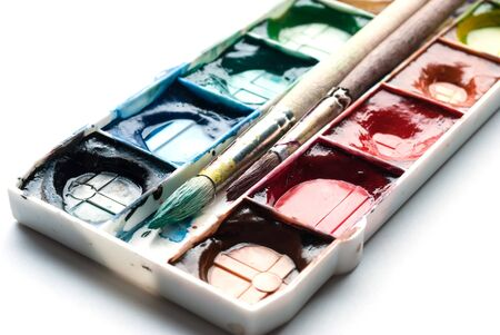 paint tin: Palette of watercolor paints with paintbrushes and space for your text. Stock Photo