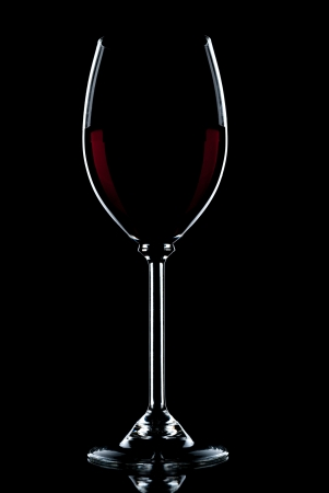 over black: Glass of red wine on a black background.