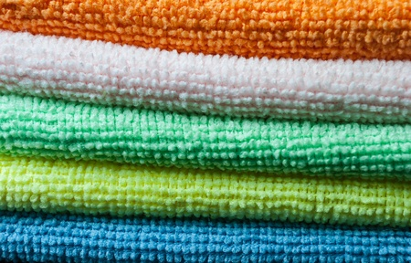 Closeup stack of colorful towels. Horizontal layout. Stock Photo