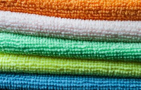orange washcloth: Closeup stack of colorful towels. Horizontal layout. Stock Photo