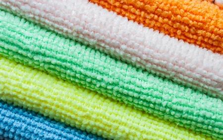 orange washcloth: Closeup stack of colorful towels. Diagonal layout. Stock Photo