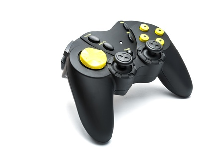 Black game controller with yellow buttons isolated on white  photo