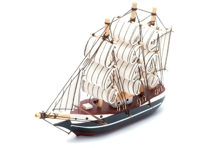 Small model ship isolated on white background  photo