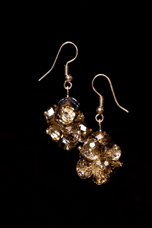 zircon: Shining elegant modern earrings with zircons isolated on black