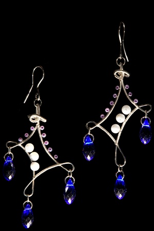 wirework: Unique handmade wire-work earrings with blue drops and violet beads Stock Photo