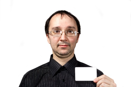 positiv: Solid men in black shirt with businesscard isolated on white
