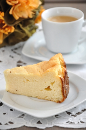 Cheesecake with a cup of coffee photo