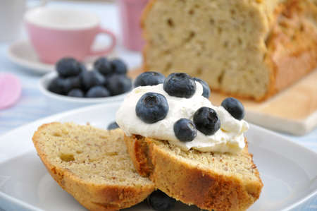 scrumptious: Pound Cake with cream and blueberries Stock Photo