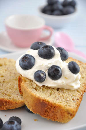 pound cake: Pound Cake with cream and blueberries Stock Photo