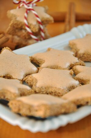 cinnamon flavoured star shaped biscuits  photo