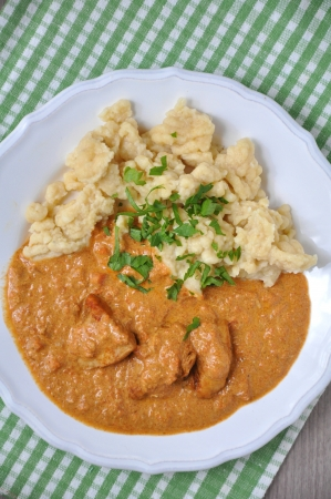 Paprika goulash with dumplings photo