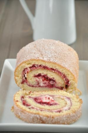 Biskuitroulade, Cake with jam photo