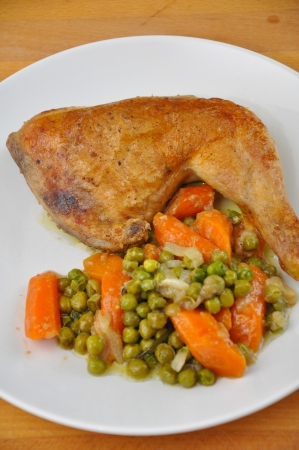 Roasted Chicken leg with peas and carrots photo