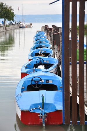 Docked boats on a lake photo