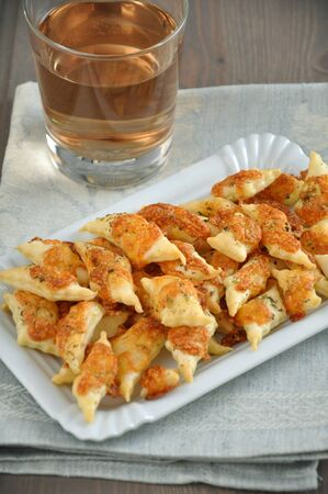 Puff pastry with cheese chips wine photo