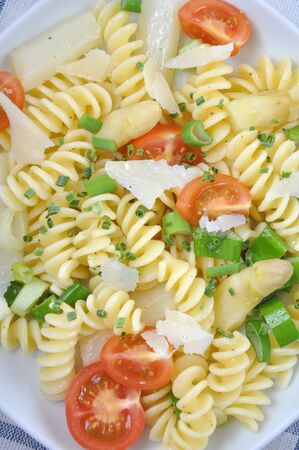 Pasta with asparagus and tomato photo
