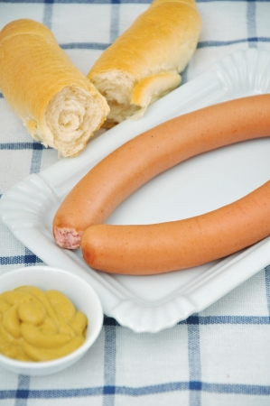 Vienna sausages with mustard and bread photo