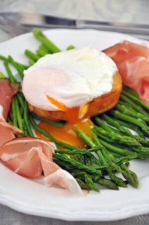 Asparagus with ham and egg photo