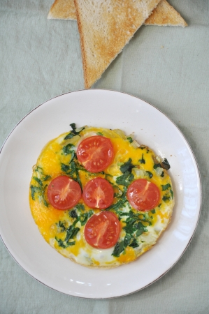Omelette with wild garlic and tomatoes photo
