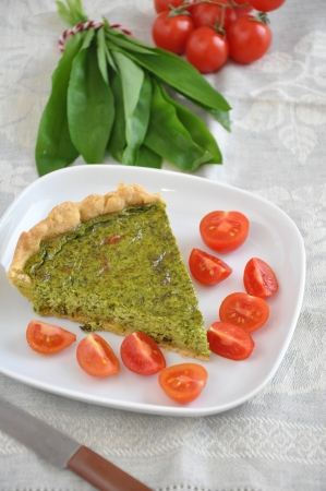 Quiche with wild garlic and tomatoes photo