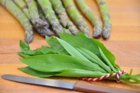 Fresh asparagus with wild garlic photo