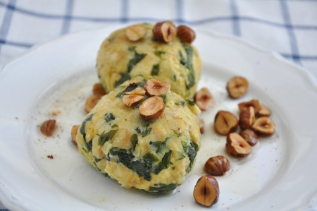 German bread dumplings with spinach and hazelnut butter