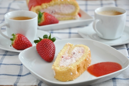 fresh piece of swiss roll with strawberry cream  photo