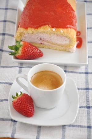 fresh piece of swiss roll with strawberry cream  photo