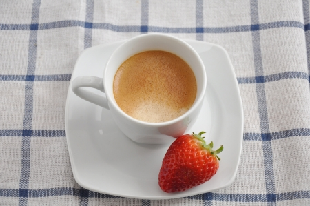 Coffee cup with strawberry photo