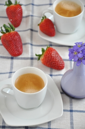 Coffee cup with strawberries and flowers Stock Photo - 19241726