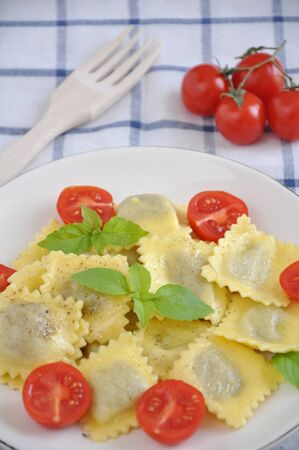 Cooked tortellini with tomatoes and basil Stock Photo - 19241719
