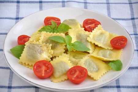 Cooked tortellini with tomatoes and basil photo