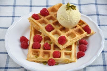 Delicious waffles with ice cream and fresh berries photo