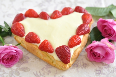 Heart Shaped Vanilla Cake with strawberries photo