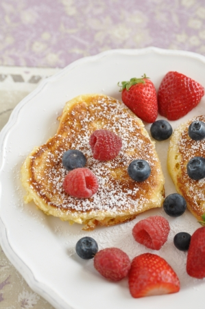 Heart Shaped Pancakes with fresh berries photo