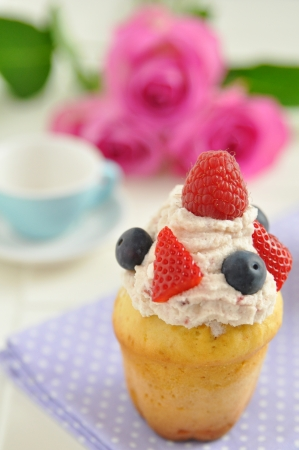 tasty cupcakes with berries photo