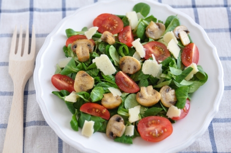 Healthy Salad with mushrooms, tomatoes and cheese photo