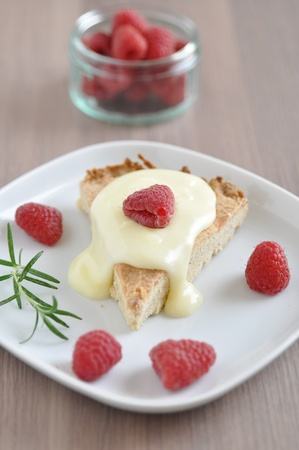 Shortbread Cake with vanilla sauce and raspberries photo