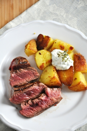 Steak with potato wedges photo